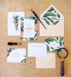 Paired with modern typography, pineapple and banana leaf illustrations set the tone for a sophisticated destination wedding. Blush and mint accents add a soft touch to this tropical invitation suite.