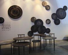 Интересные столы и панели похожие на деревянные спилы.