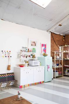 Who cooks and eats here: Joy Cho of Oh Joy! and her studio team Where: Los Angeles, CA Rent or Own? Rent Joy Cho is a blogger, designer, food enthusiast, mom and all-around trendsetter, which you'll know if you read her immensely popular blog. A few months ago Joy moved her daily work into a studio space in Los Angeles, and it radiates happiness, creativity and fun — especially in the kitchenette, which has lots of great ideas for both home and work cooking spaces. (Plus, check out that…