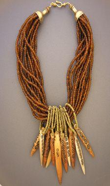 Antique Beads Style, soul, and history Tribos e etnias - Usar miçangas marrons em diferentes tamanhos e tons, ping. prateado tribal.