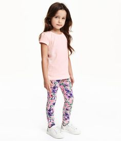 Treggings in thick jersey with an elasticized waistband, mock pockets at front, and regular pockets at back.