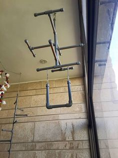 Super cool hanging bird gym of PVC from The Parrot's Workshop on facebook