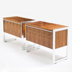 Anonymous; Rosewood and Aluminum Consoles by Howard Miller for MDA United Kingdom, 1960s.