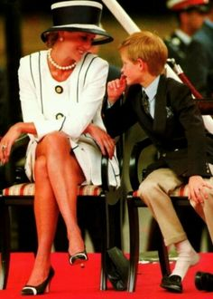 Princess Diana with son Prince Harry honouring VJ day in Britain, 1995.