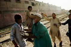 Children playing cricket on the tracks in Karachi celebrated a winning hit.Slums crowd the train lines that snake through the city, pushing up against the tracks. Andrea Bruce for The New York Times