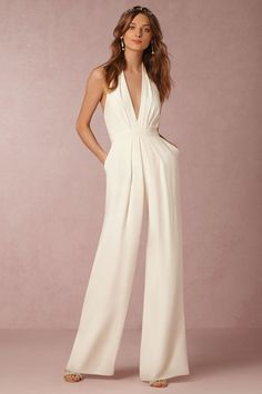 Jumpsuit wedding dress idea -  Ideal for your shower, engagement party, or as a quick reception switch, this chic jumpsuit is equal parts modern and sophisticated. Featuring a plunging v-neck and flowy wide-legged silhouette, we recommend finishing the look with a pair of glitzy heels.  Style BHLDN MARA JUMPSUIT. Get more wedding dress inspiration by @bhldn on @weddingwire!