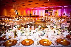 Regal look & pink #uplight lighting highlight this #venue! Great photo via #bellethemagazine