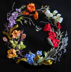 The black background of this silk embroidered wreath really sets off the colours - don't you think?  Image courtesy of http://ladda.gallery.ru/watch?a=beHa-dXBr