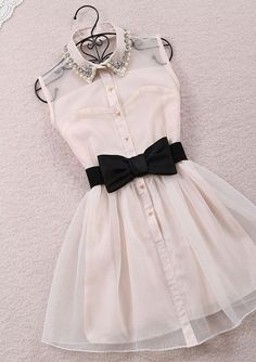 oh my gosh! this dress in not just a want but a need. I love the belt and the bow and the collar. this is my personality in a dress.
