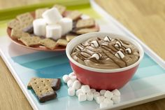Dip into smooth and creamy s'mores with this delicious twist on a campfire classic, made irresistible with peanut-buttery goodness.-- peanut butter smores dip