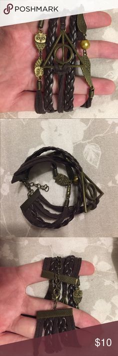 Harry Potter leather bracelet (Not urban) 5 strand leather bracelet with snitch, owl, and deathly hallows charms lobster clasp. I've never worn it so no wear and tear. Hot Topic Jewelry Bracelets