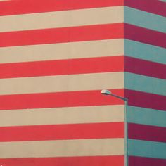 Red and ecru striped building. Love the composition with the streetlamp.