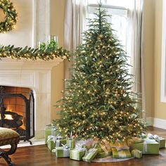 With lush, full foliage and pre-lit with bright mini-lights, ready to decorate. Our new tree!