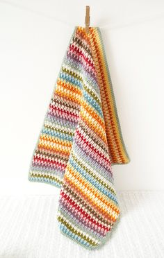 Crochet your own unique Retro Baby Blanket! Easy to make with full instructions. Includes lots of photos to guide you through making this lovely bright blanket for your baby or as a wonderful, colourful gift. List of colours used is included in the pattern. **Included in the Instant Download are both the English and American versions of this pattern** Materials; ♥ 400g of DK yarn (lots of approx 10g scraps are ideal) I used 100% DK cotton (Drops Muskat 100% cotton yarn). You can use which…