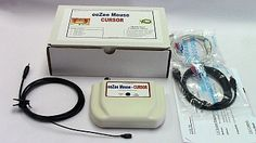 Items included in an eeZee Mouse; cables  mouse,  papers