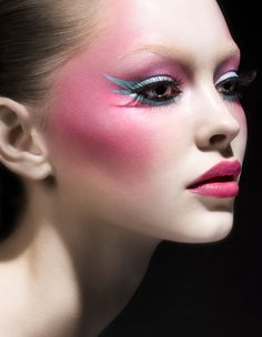 Stunning ballerina look makeup, with enflamed pink blush & eyeshadow, bright light blue winged liner and bright pink lips. Style Magazine makeup by Tanja Kern.