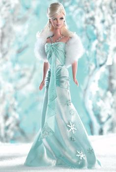 ~ I Dream of Winter™ Barbie® ~   The magic of winter inspires this cool, blonde beauty wearing a long, ice blue charmeuse gown. It has a silvery, glitter printed ice blue chiffon halter with exquisite silvery seed bead detail. She also comes with a snowy, faux-fur stole and silvery earrings — the perfect accessories to complement winter's elaborate display!