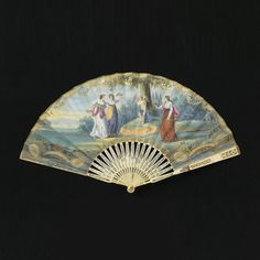 Pleated fan. Paper leaf painted in the style of Angelica Kauffman. Obverse: scenes of cupid tied to tree with women with bows, arrows and flowers. Reverse: plain. Ivory sticks carved à jour with a central cartouche in relief of a reclining woman.