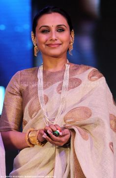 Rani in a lovely ivory handloom Saree. Not loving the jewellery selection though