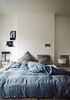 Comfy bed on floor with cool colors
