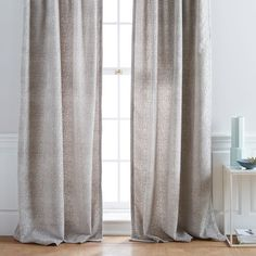 You want heavy curtains in the front room that can be used for privacy at night. I really love the texture on these. Also, you want the living room/dining room curtains to be very complimentary without being the same.