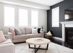 Anyone else love a bold charcoal wall? It's definitely not for everyone and that's okay! This colour is Iron Ore by ⠀⠀⠀⠀⠀⠀⠀⠀⠀⠀⠀⠀ 📷: Black And White Living Room, Narrow Living Room, Accent Walls In Living Room, White Rooms, Living Room Grey, Home Living Room, Living Room Decor, Home Fireplace, Living Room With Fireplace