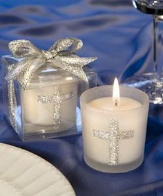 "Silver Cross Themed Candle Favors, 30 by FavorWarehouse. $31.72. Share a blessing with your family and friends with these silver cross themed candle favors Looking for christening, first communion or confirmation favors, or classic gifts that are appropriate for any religious occasion? These candles make a perfect choice! Each 2"" x 1 ¾"" favor features a sturdy white frosted glass holder decorated with a sparkling silver cross design, with a white poured candle inside. Packa..."