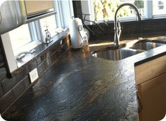 Cosmos Wave Granite (shown with antiqued or leathered finish)    Alternate Names: N/A    Price Group: $$$$  Country Of Origin: Italy  Primary Colors: black  Level Of Variation: medium