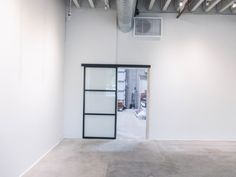 Our team recently installed this commercial, single-panel Wall Slide with a black frame and clear glass between a showroom and a warehouse. If you have spaces in your business that could use separating, consider a Wall Slide or Room Divider from Classic! We have all of the features available for your customization to give your business the aesthetic you want it to have.  Visit www.chiproducts.com or call (866) 567-0400 for a free estimate! Common installation cities include Fullerton…