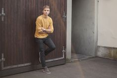 Shop this look for $91:  http://lookastic.com/men/looks/mustard-crew-neck-sweater-and-charcoal-chinos-and-grey-suede-high-top-sneakers/3112  — Mustard Crew-neck Sweater  — Charcoal Chinos  — Grey Suede High Top Sneakers
