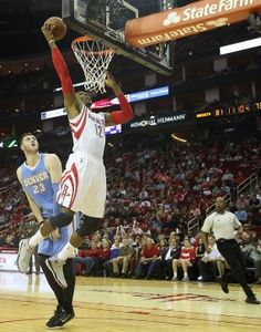 Rockets center Dwight Howard (12) misses a lay up against Nuggets center Jusuf Nurkic (23) in the second half.