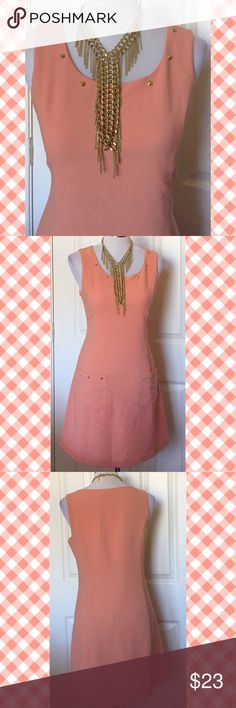 """Blu Pepper studded dress This pretty dress features a striking muted salmon color and an interesting gold stud detail at the neckline and on both front pockets. Fully lined, Fabric 98% poly/2% spandex. Bust 36"""", waist 32"""", length 33"""". Dresses"""