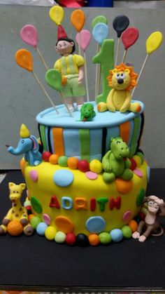 A colorful animal themed first birthday eggless chocolate cake for lil adrith !!