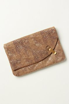 I like the circular latch detail on this clutch....and I carry it all the time!!!