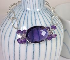 A personal favorite from my Etsy shop https://www.etsy.com/listing/166699472/sterling-silver-and-amethystbbracelet-by