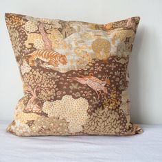 Cushion cover in rare vintage Sanderson fabric. This colourway is hard to find and the fabric is vintage 70s. It depicts a jungle scene with tigers and wildlife among the trees, in warm hues of ochre, orange and olive. It has a concealed zip across the back, and french seams which means no raw edges, making for a durable cushion cover.  45 x 45 cm (18 x 18 in) Zip closure Cotton  This would make an excellent accent to a warm bohemian living room or complement a room with a 70s vibe.
