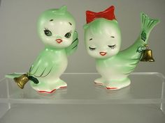 Vintage green and white birds with bells salt and pepper shakers. Guess the bells would let everyone know how much you were putting on!
