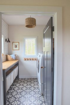 Not all houses have a laundry room. But if your house has one space room that can be used as a laundry room, why not? The existence of this laundry room Laundry Room Tile, Farmhouse Laundry Room, Room Tiles, Laundry Room Design, Basement Laundry, Laundry Room Folding Table, Laundry Tips, Grey Interior Doors, Laundry Room Inspiration