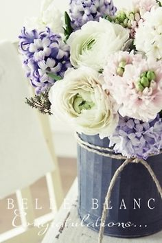 What do you think about the colors?  Soft blush/pink, cream, soft lilac/lavender.  Possibly add in dusty miller floral to tie in some soft grey