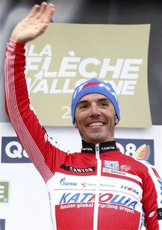 Spain's Joaquim Rodriguez Oliver of the Katusha team celebrates on the podium, after he won the Belgian cycling classic Walloon Arrow/Fleche Walonne, in Huy, Belgium, Wednesday, April 18, 2012. Swiss cyclist Michael Albasini of the Greenedge Cycling team placed second, followed by Belgium's Philippe Gilbert of the BMC Racing team.