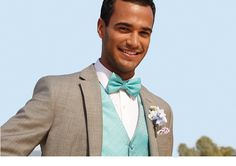 A pastel under a grey suit is a refreshing change from the classic black tux! #menswearhouse #weddings