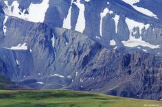 greater yellowstone ecosystem pictures | Phelps Mountain grassland contrasts sharply with the rock face of ...