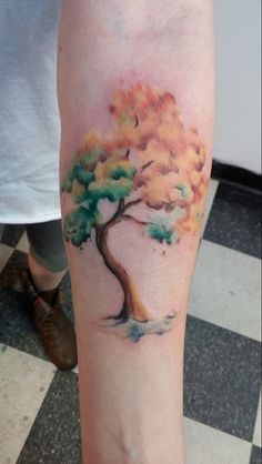 Tree watercolor tattoo on forearm