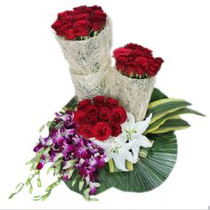 30 Red Rose and 5 purpal orchid & 2 white oriental Lilly arrangement with white jute Flower Garland Wedding, Flower Garlands, Order Flowers, Montreal, Red Roses, Orchids, Oriental, Anniversary, Garden