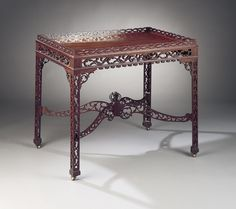 This delightful English mahogany tea table is fashioned in the Chinese Chippendale style, circa 1840 ~ M.S. Rau Antiques