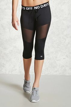"An athletic pair of stretch-knit leggings featuring a capri cut, a foldover drawstring waistband with a repetitious ""No Days Off"" graphic, front mesh-inserts, and moisture management."