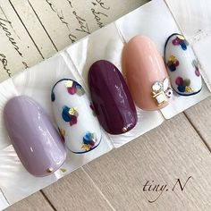 Cute multi colored nails with watercolor free hand design