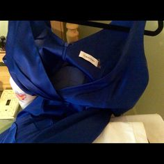 Dinner Date Dress Cobalt blue Calvin Klein.  Comes to the knee.  Satin like material.  Excellent condition, maybe worn two times Calvin Klein Dresses