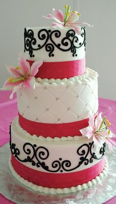 Elegant three layered cake with designs and color