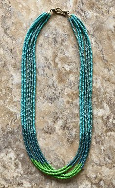 Six strand necklace is made of green, blue, and turquoise seed beads, and finished with an antique gold swivel hook. Diy Jewelry Necklace, Mom Jewelry, Seed Bead Necklace, Seed Bead Bracelets, Seed Bead Jewelry, Multi Strand Necklace, Necklace Designs, Fashion Necklace, Jewelry Gifts